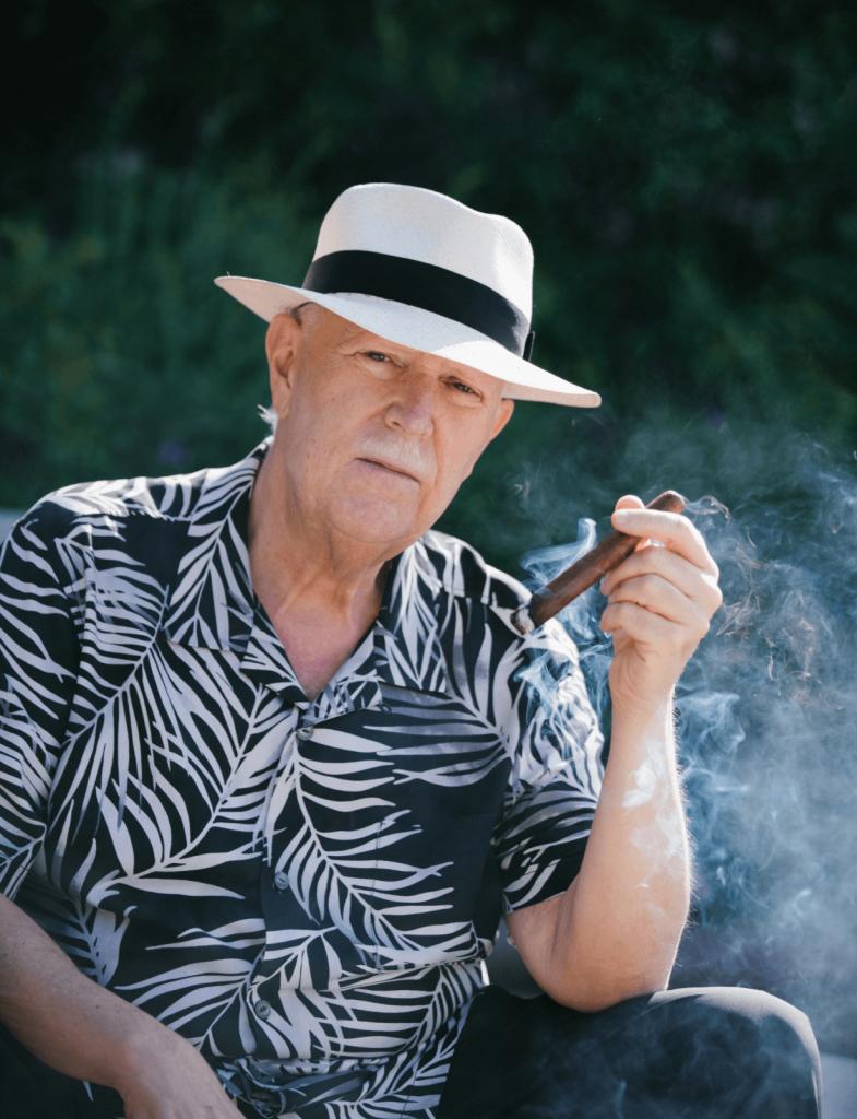 Rob enjoying a cigar outside