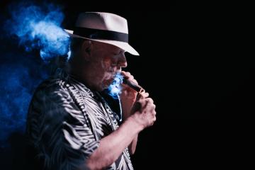 Rod Kurthy lighting a cigar
